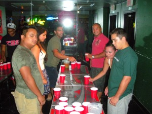 The flip cup obstacle course include the standing spins, laps around the table and a slalom run.
